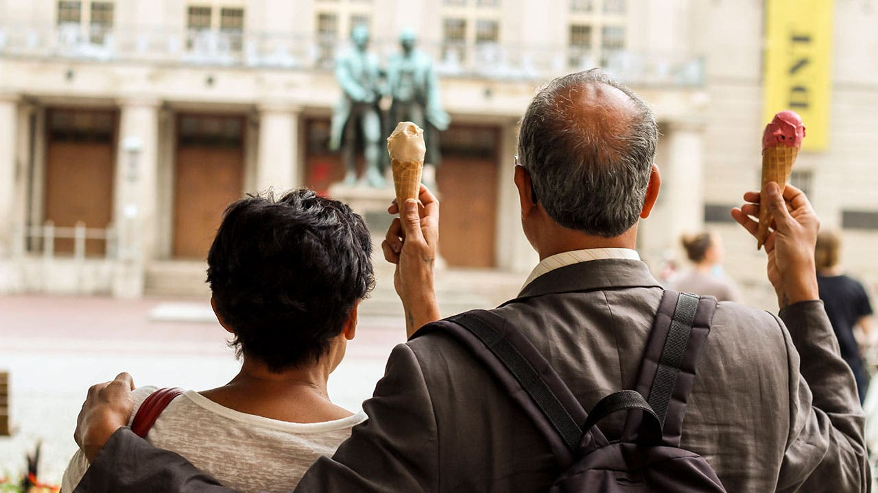 Older couple eating gelato