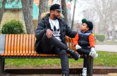 Father and son sitting on bench