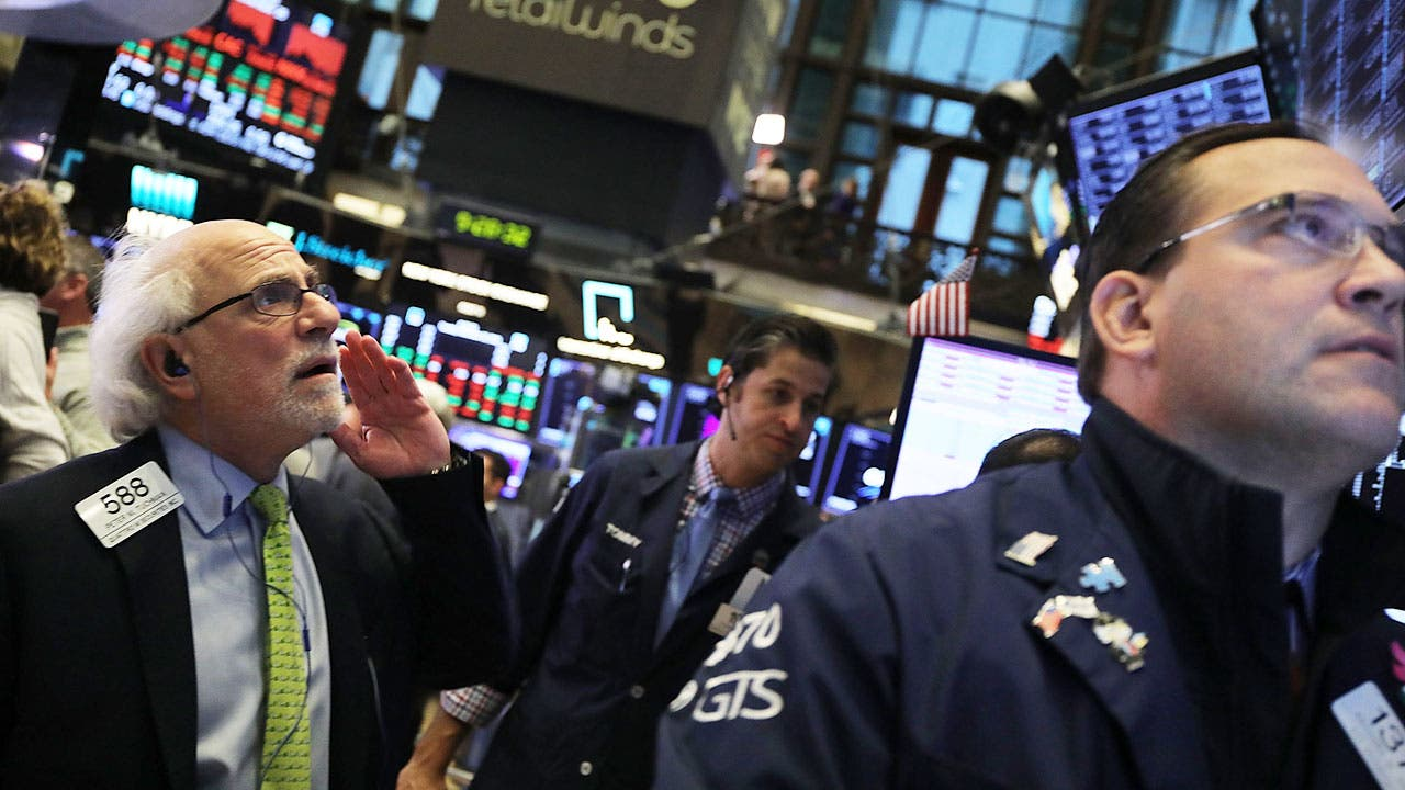 Stock brokers on trading floor in New York Stock Exchange