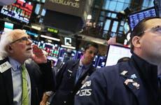 Stock brokers on trading floor in New York Stock Exchange