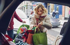 Mother loading car with holiday gifts