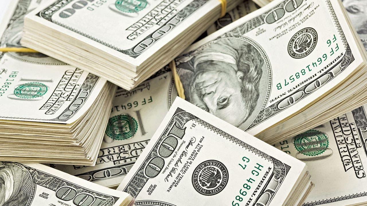 Piles of $100 bills