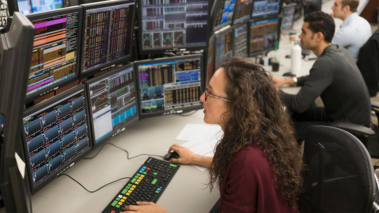 Stock brokers looking at stock trends