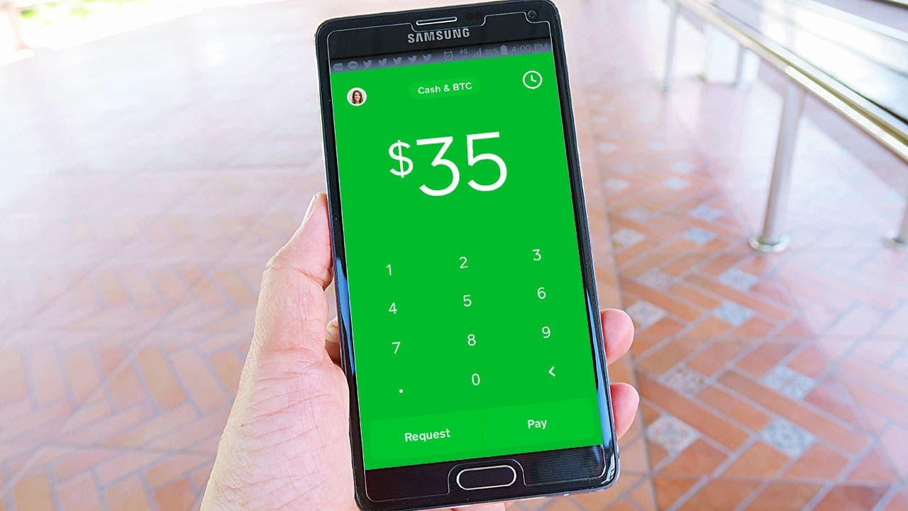 Woman using Square Cash app