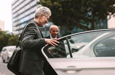 Businessman getting into rideshare car