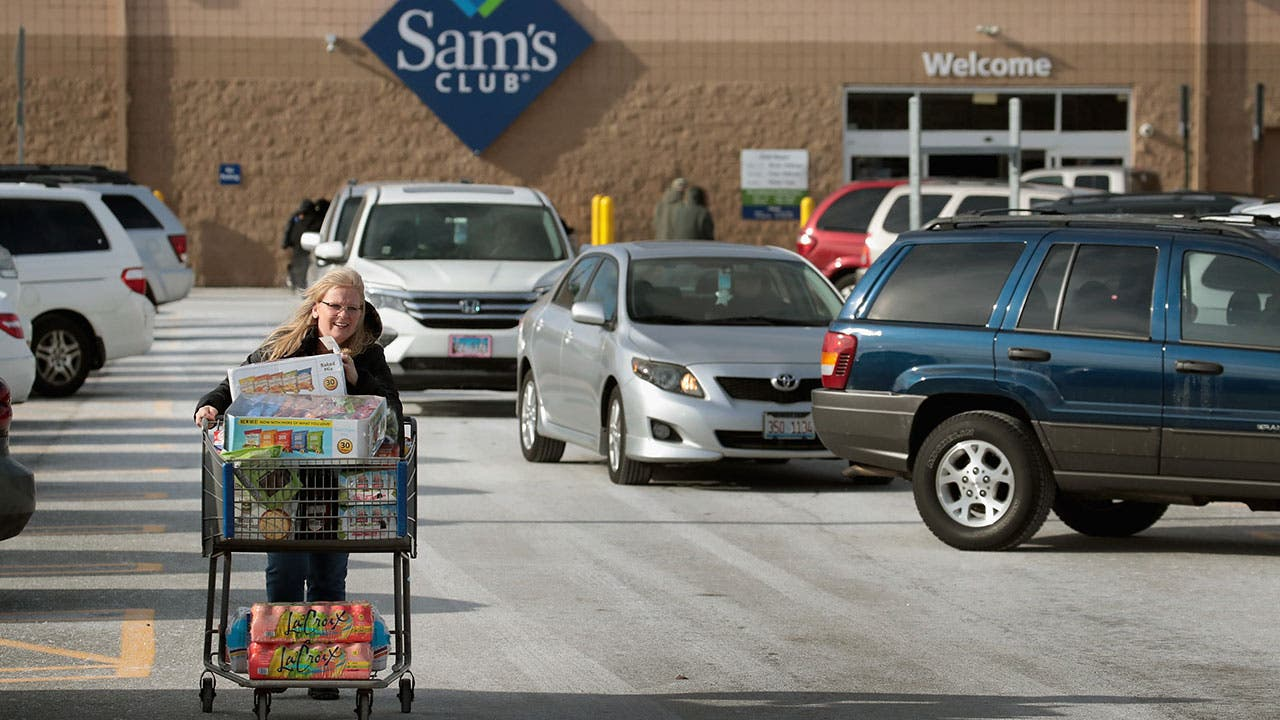 Woman pushing cart in Sams Club parking lot