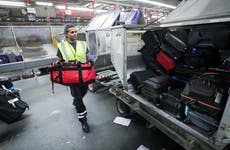 Airport freight worker moves luggage