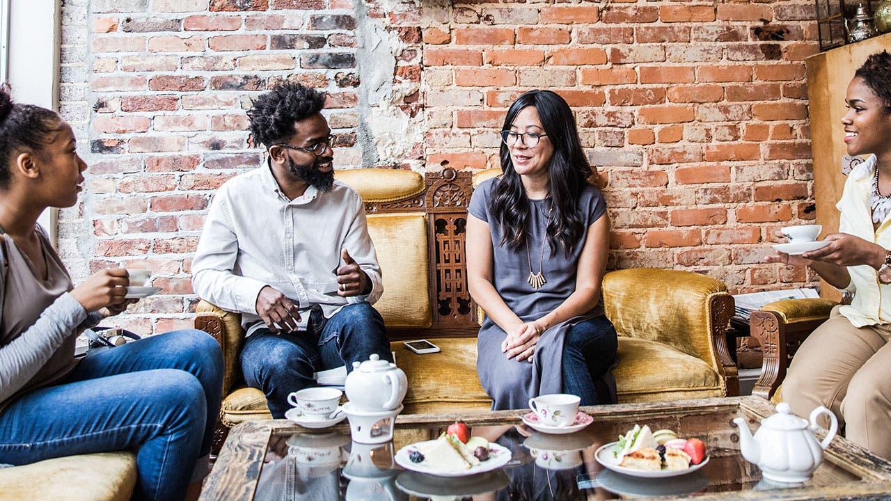 Friends talking over tea