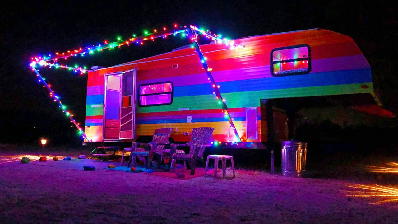 Christmas lights decorating a brightly colored trailer