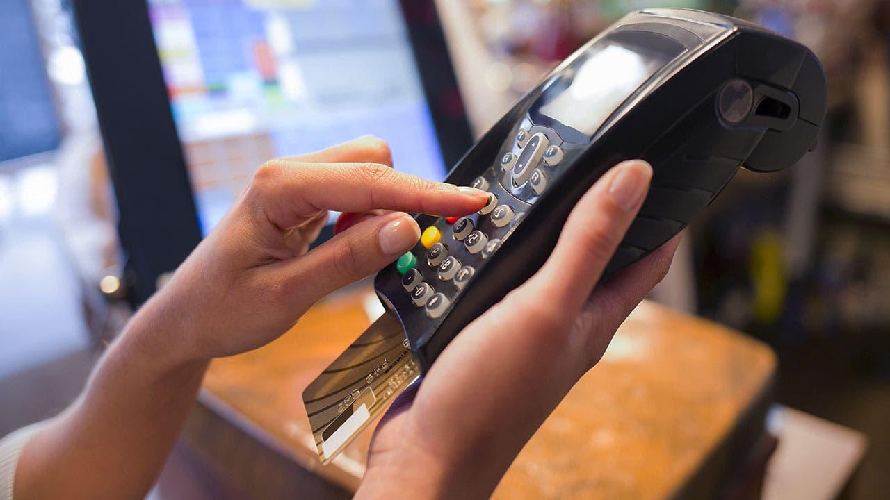 Woman paying credit card