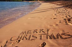 Merry Christmas written in sand