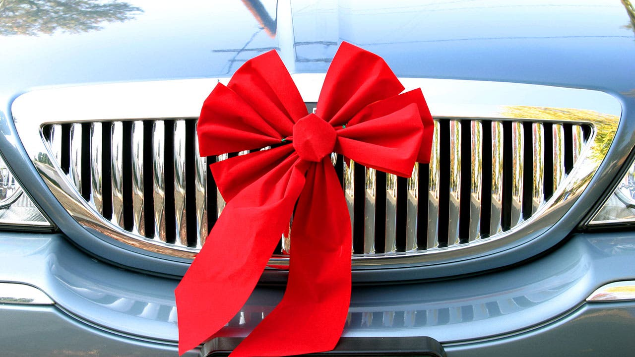 Brand new car with ribbon