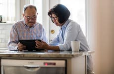 Couple banking on tablet