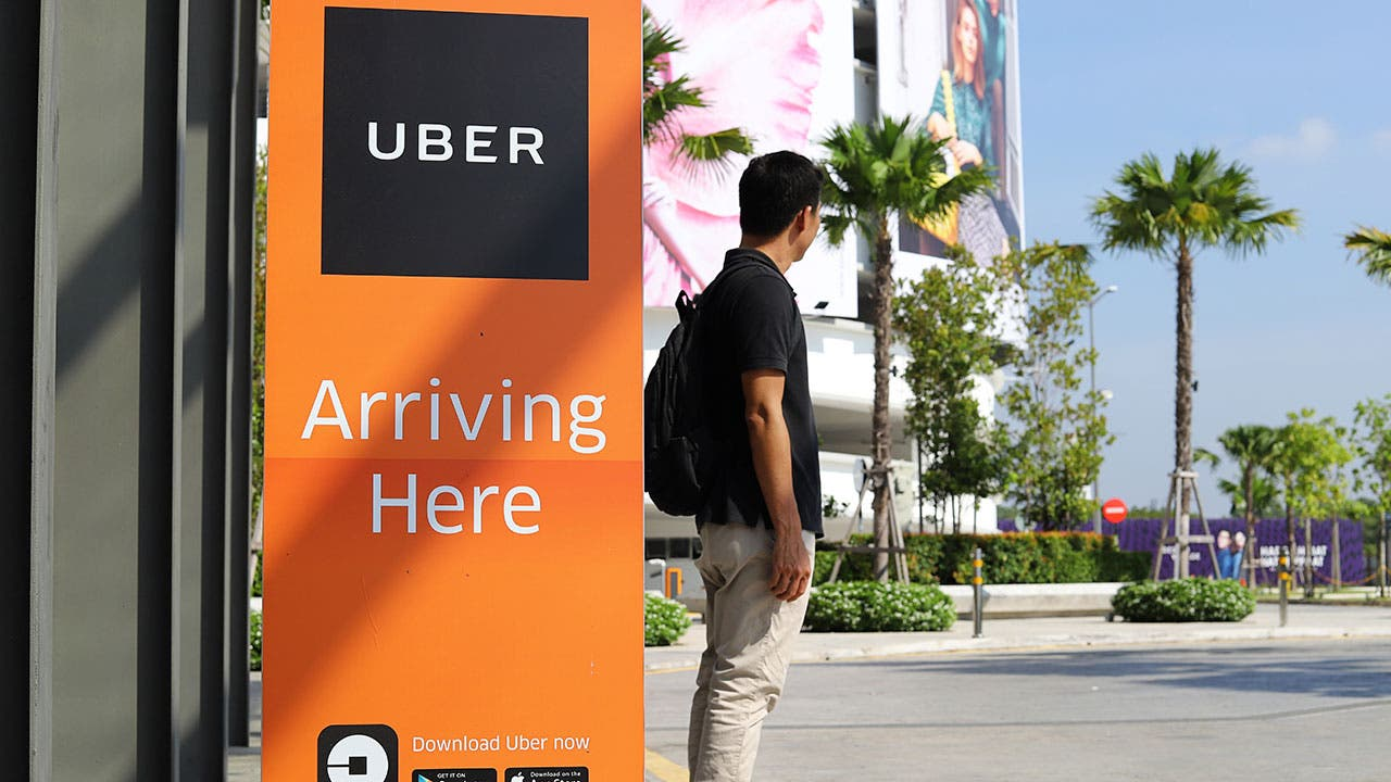 Man waits for Uber pick up