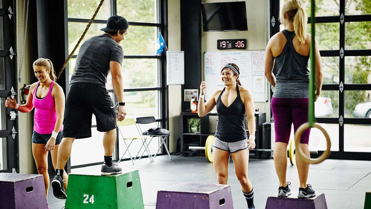 Fitness instructor leads a cross fit class