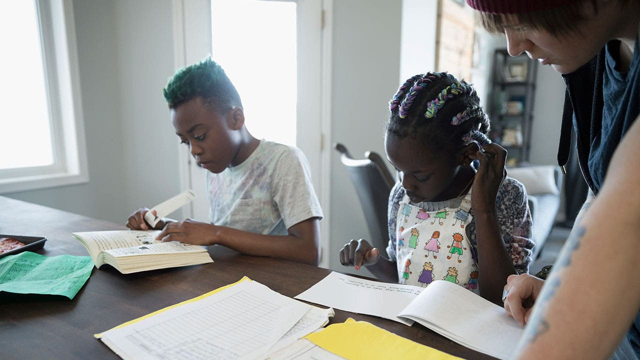 Tutor helps children with homework