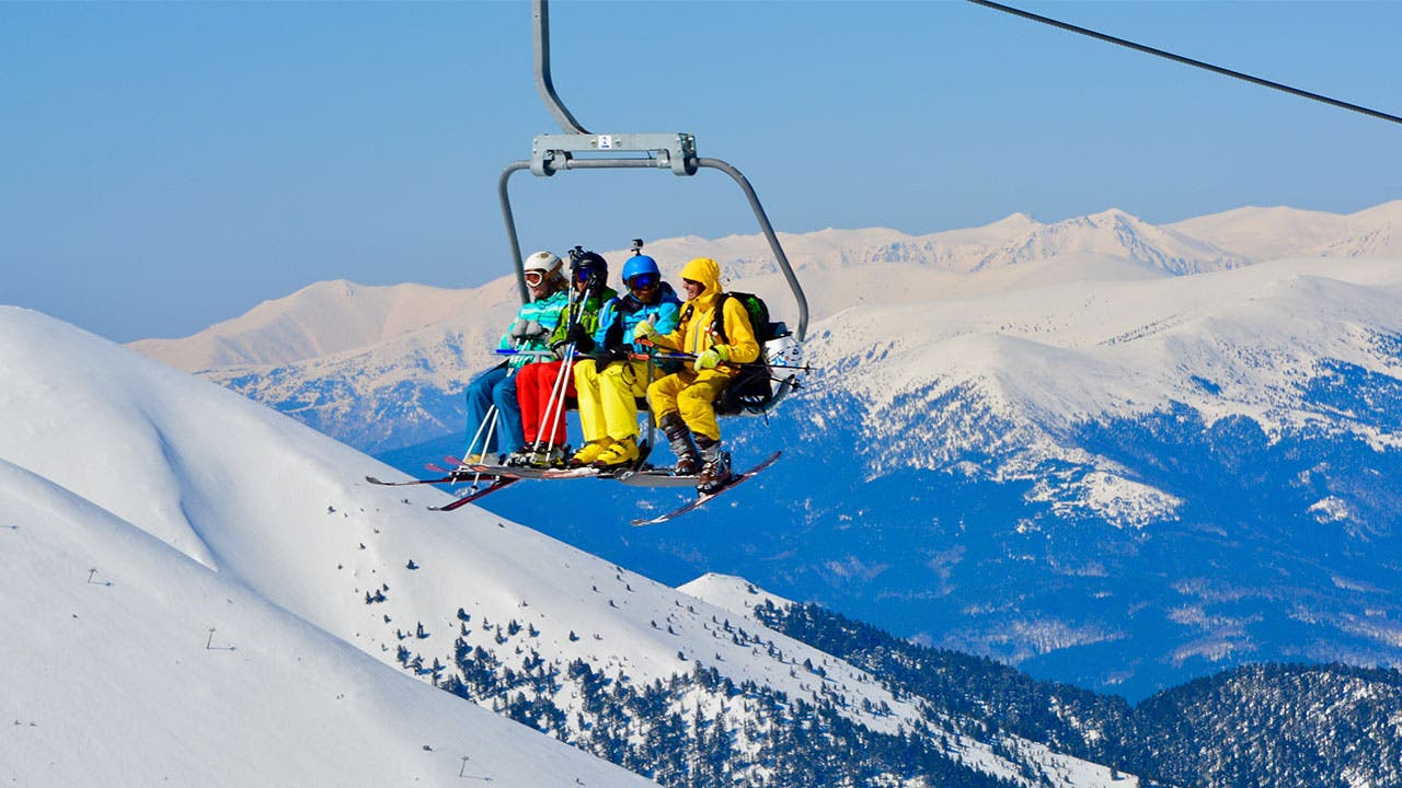 Skiers on ski lift