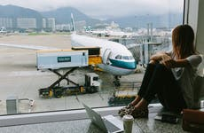 Woman waiting for plane at airport