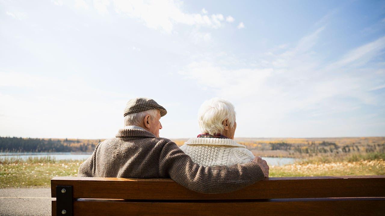 Elderly couple on park bench