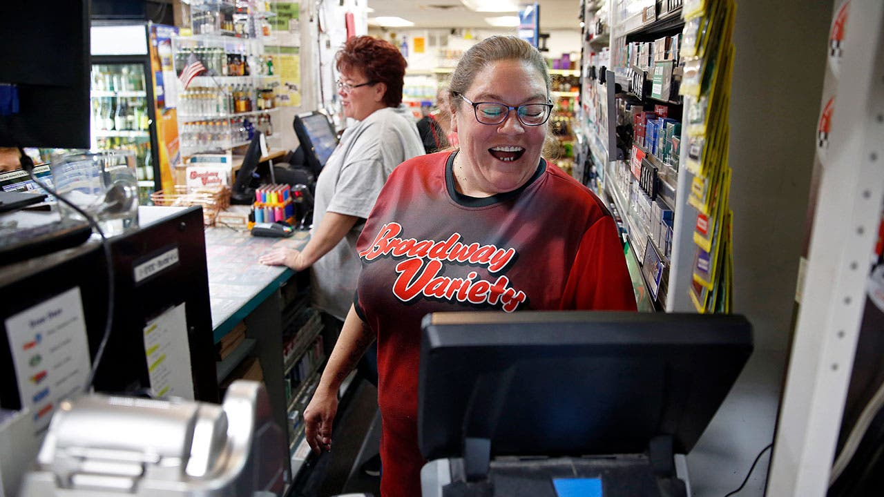 Cashier selling lottery tickets