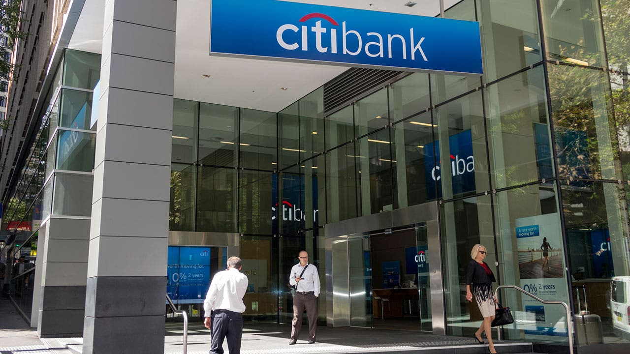 People walking out of Citibank