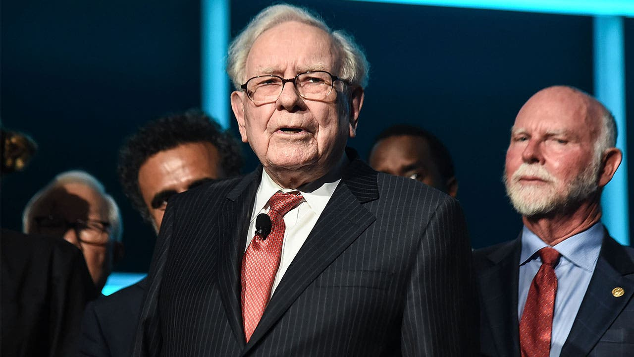 Warren Buffett receiving an award