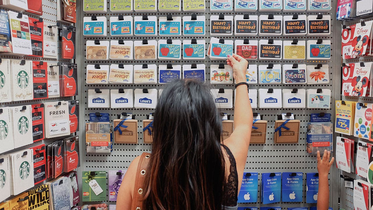 Woman choosing gift card
