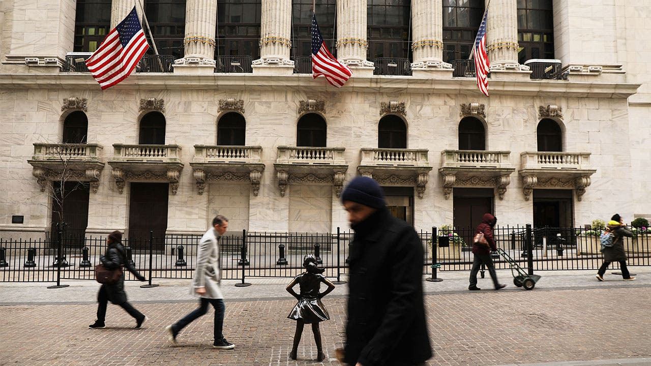 Pedestrians walking past the New York Stock Exchange