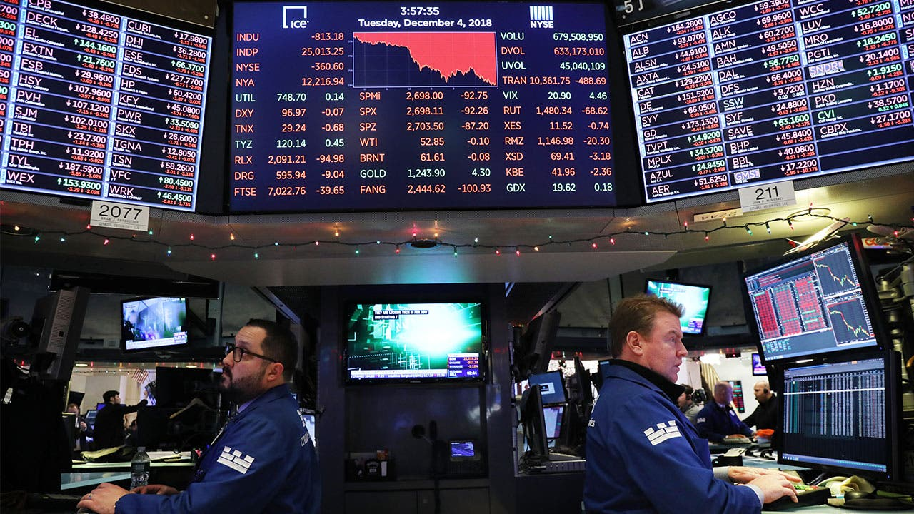 Stock brokers on the NYSE trading floor