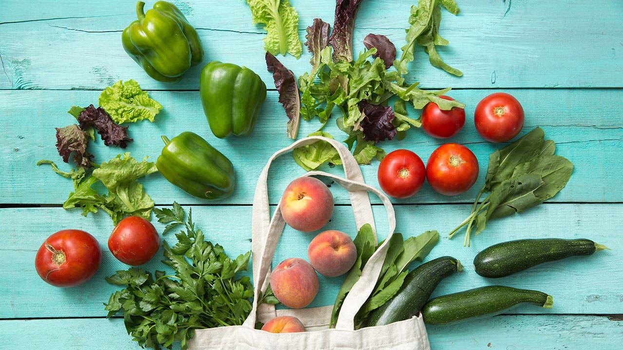 Grocery bag spilled with vegetables