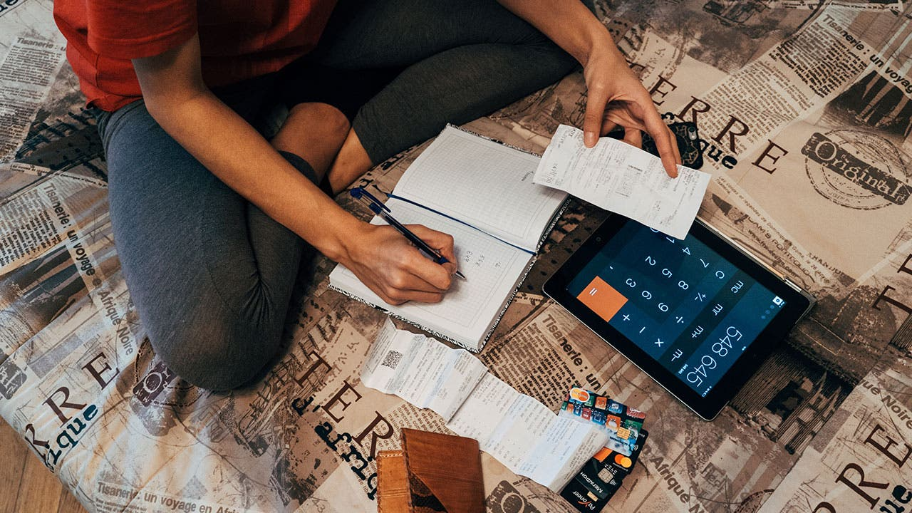 Woman going through credit card receipts at home