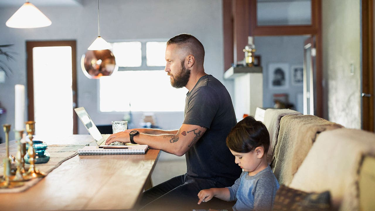Man on computer in home