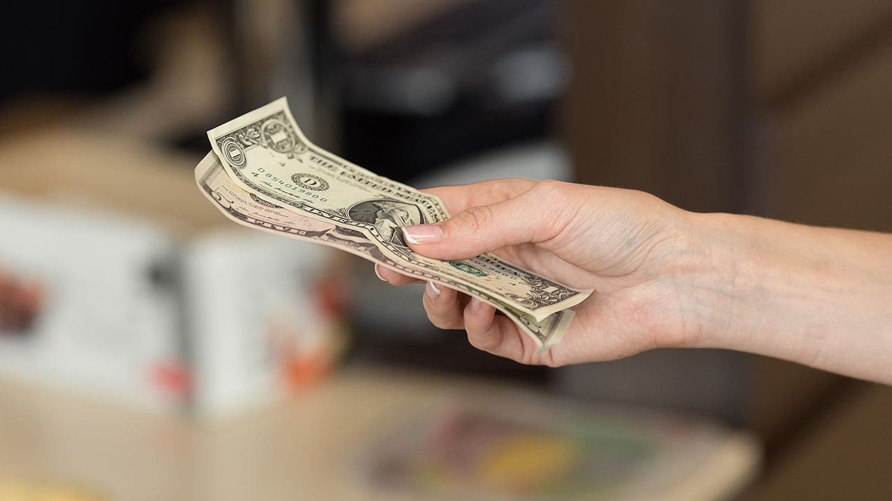 Woman paying with cash