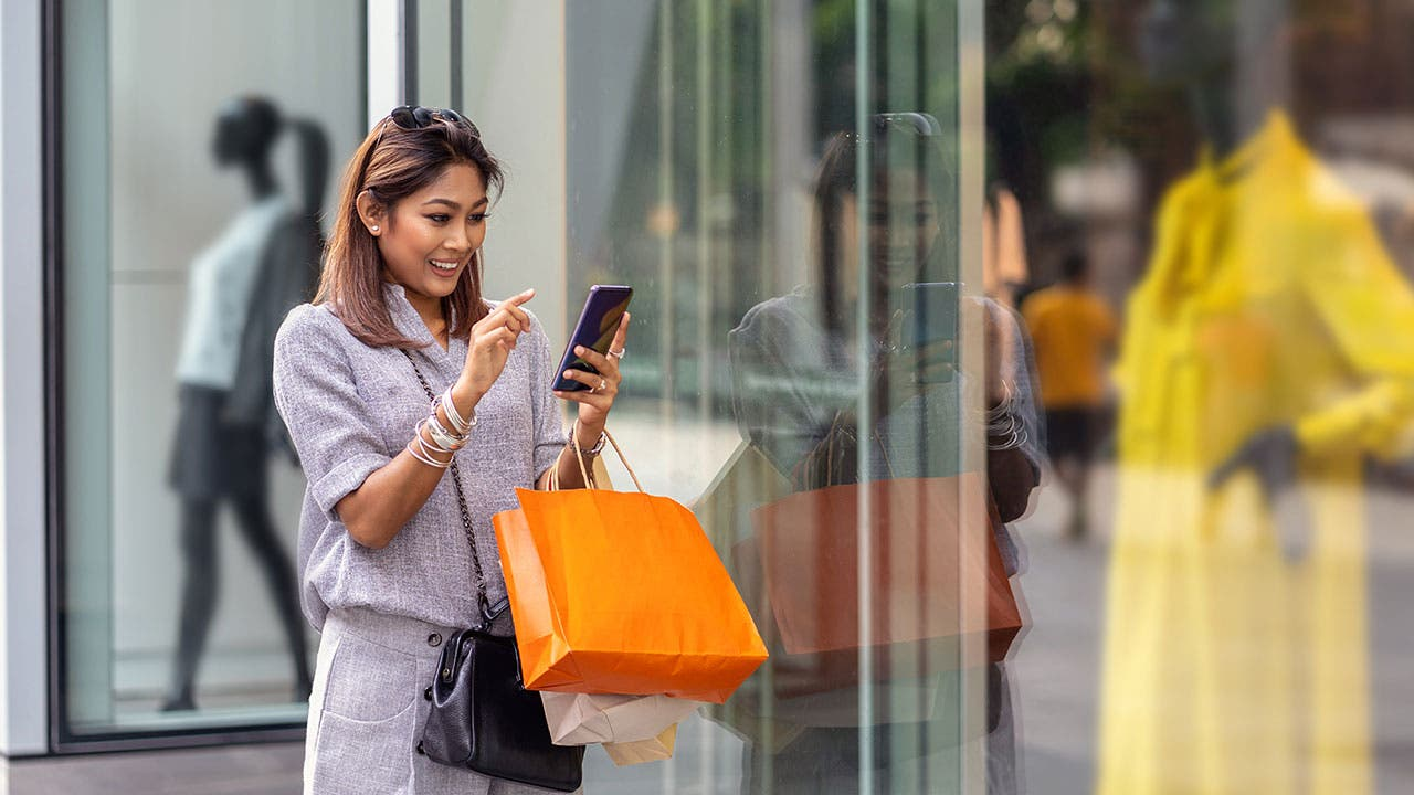 Woman on her phone shopping