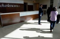 People walking into a Charles Schwab branch