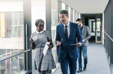 Businesspeople walking in corridor