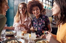 Four young women enjoying lunch at a restaurant