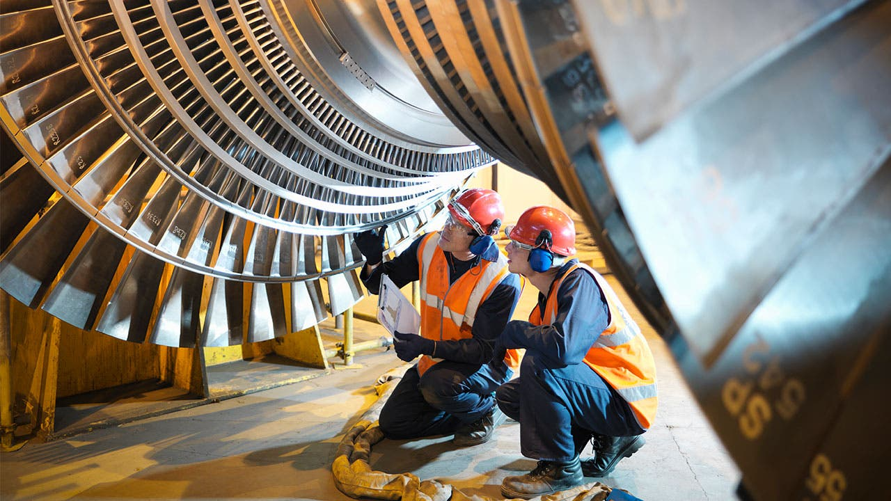 Manufacturing workers looking at a turbine