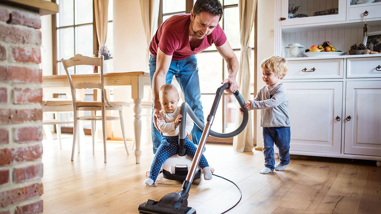 Father and sons vaccuming