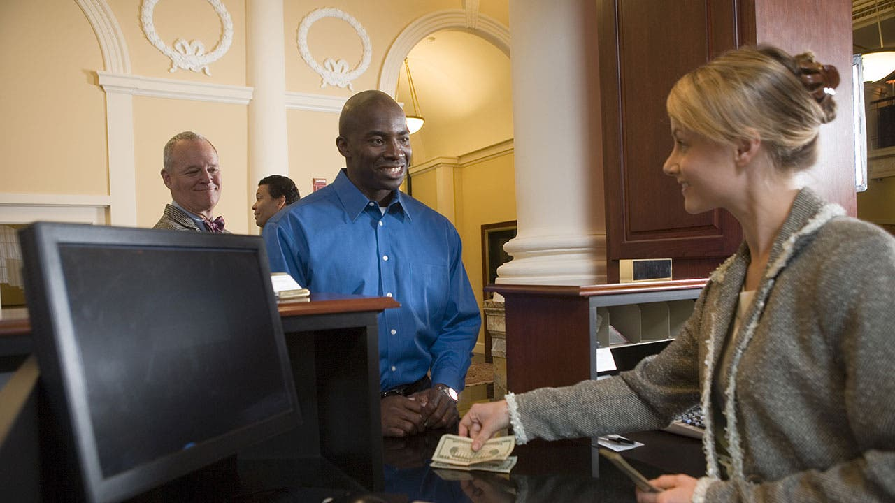 Bank teller with customer