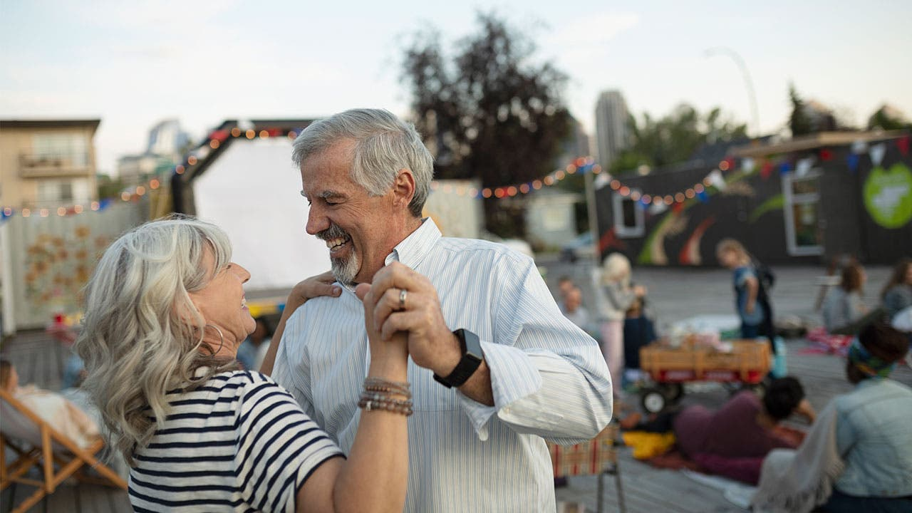 Retired couple dancing