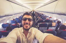 Man taking a selfie on plane