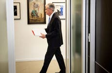 Jerome Powell walking through the Federal Reserve