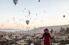 Woman solo traveller watching a balloon festival