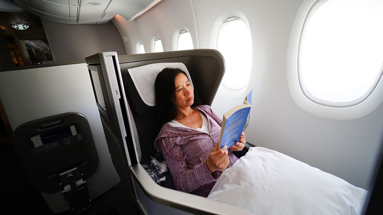 Woman reading on first class plane