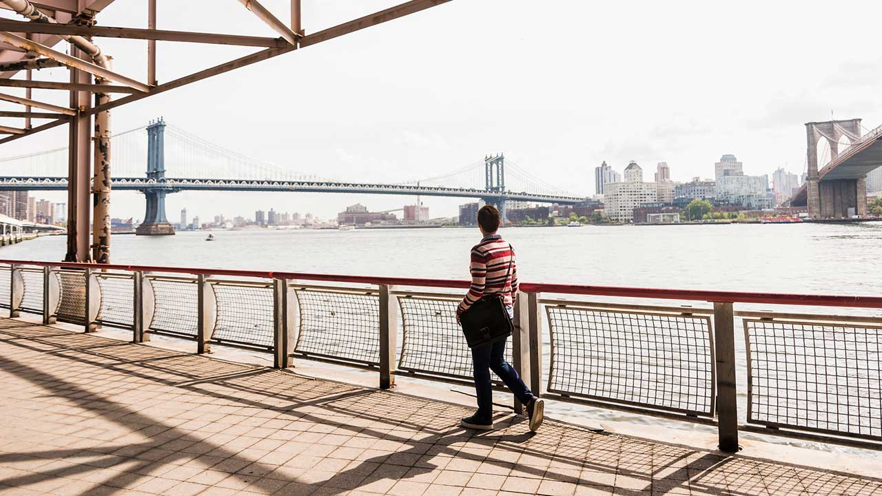 Woman walking in East River, New York City