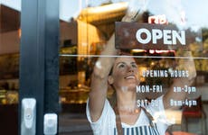 Woman opening up shop