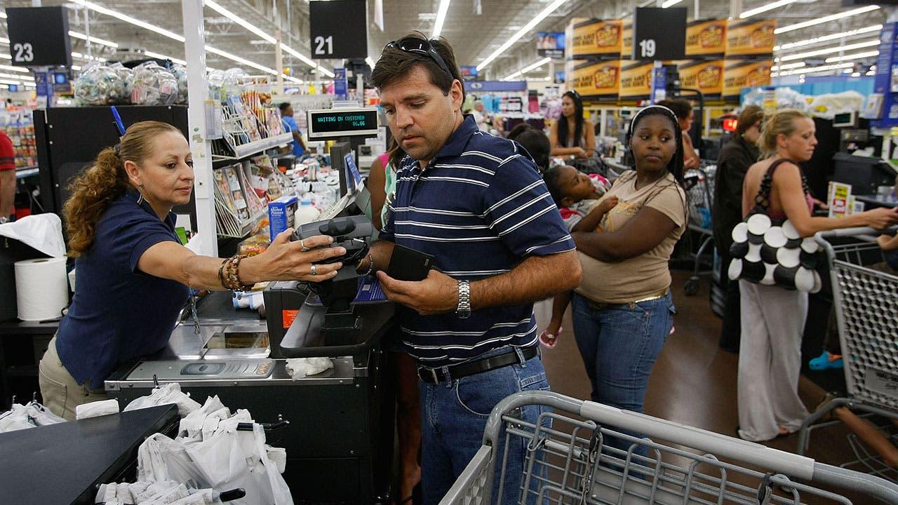 Man checks out at Walmart