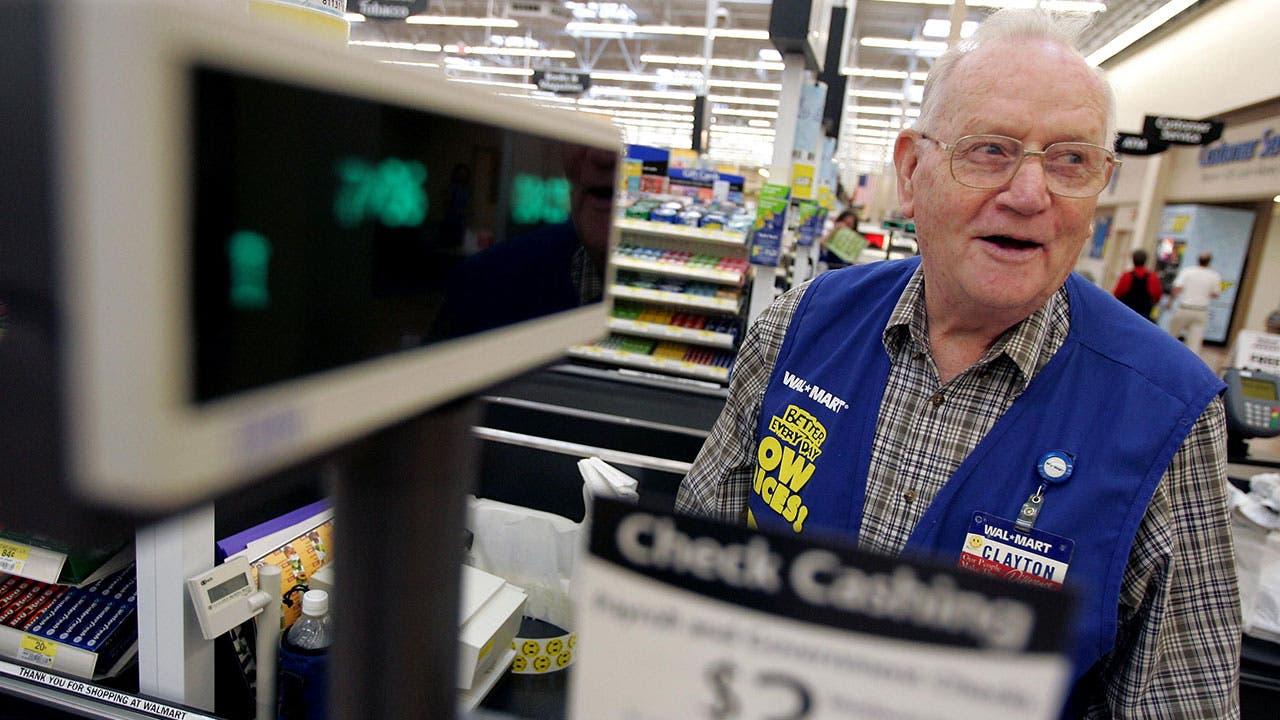 Walmart clerk at register