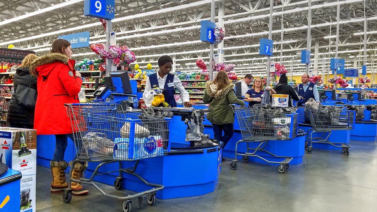 Woman checking out at Walmart